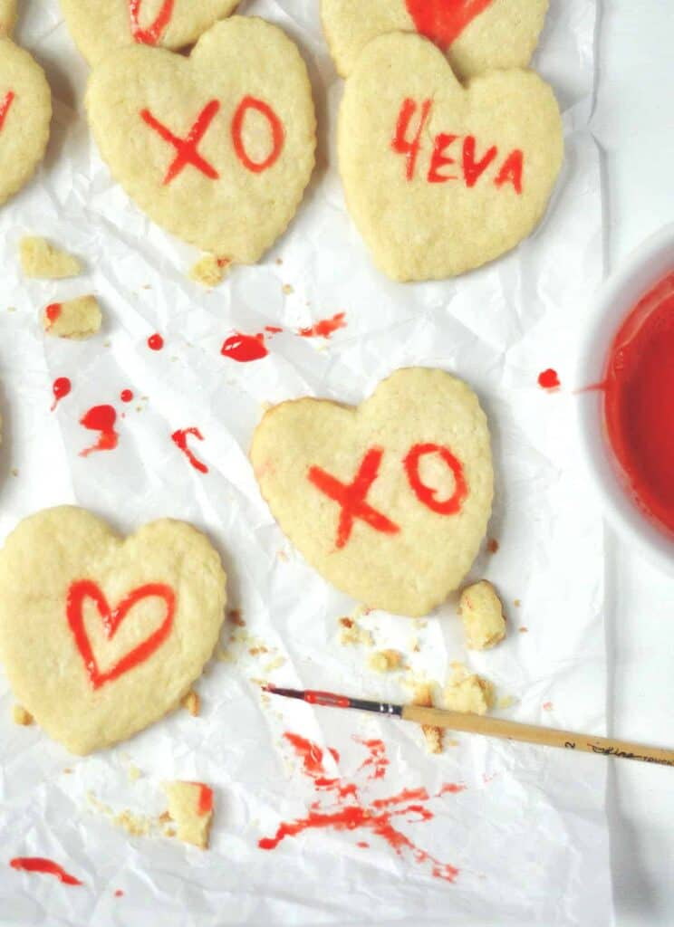 Crispy and chewy gluten free sugar cookies become your kids canvas with this fun painted Valentine's Day cookie recipe. Paint made from egg yolk and natural food coloring.