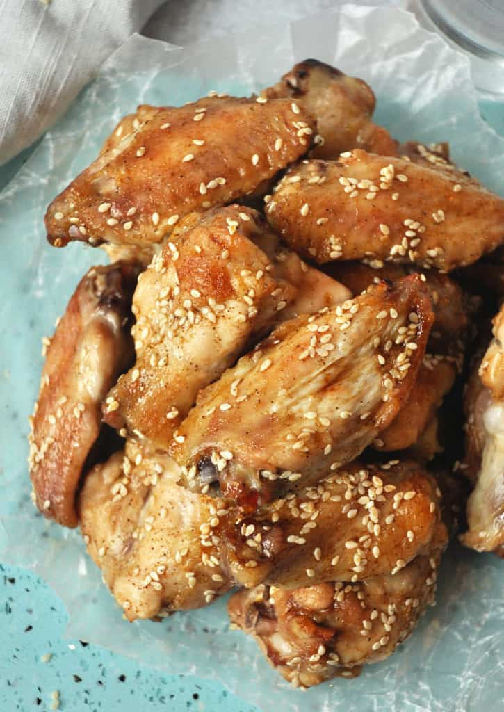 Sweet and savory Paleo wings- pineapple, coconut aminos and sesame seeds make a flavorful Asian inspired Paleo and Whole30 compliant chicken wing recipe.