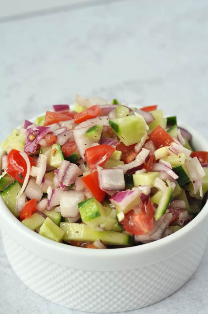 Refreshing cucumber, bright purple onion, and fresh sweet tomatoes are the perfect combination for Greek salsa. This versatile side dish can be your next appetizer or even topping for your favorite grilled meats.
