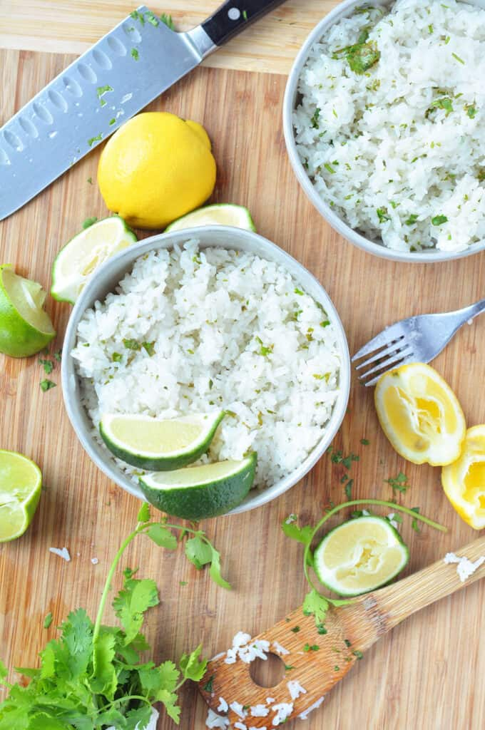 Cilantro Lime Rice on cutting board with both bowls and ingredients