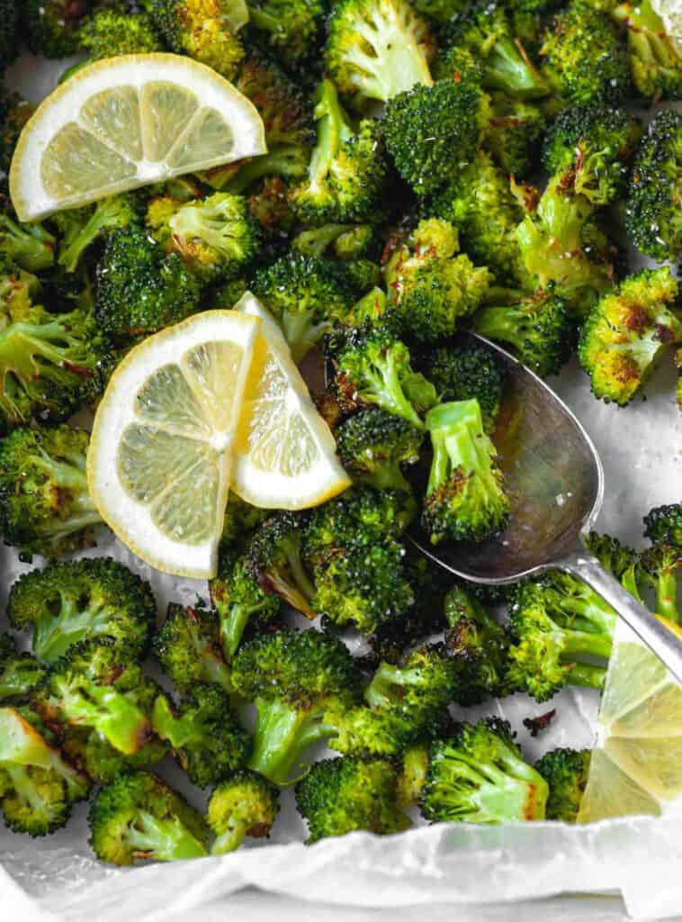 close up with spoon of broccoli and lemon slices