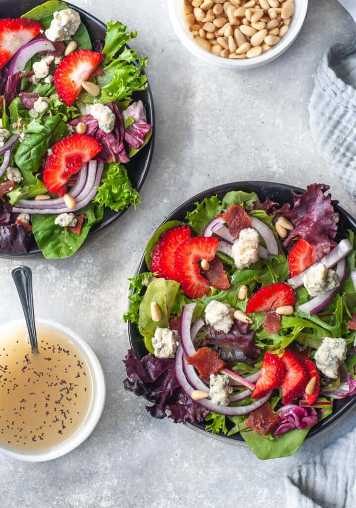 vegan poppy seed dressing with two strawberry salads