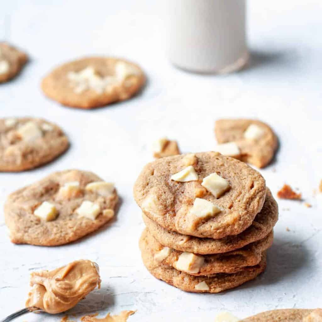 stack of cookies with milk in the background