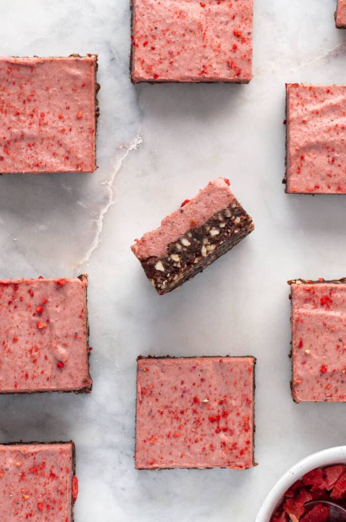 no bake paleo strawberry chocolate bars out and one flipped on its side