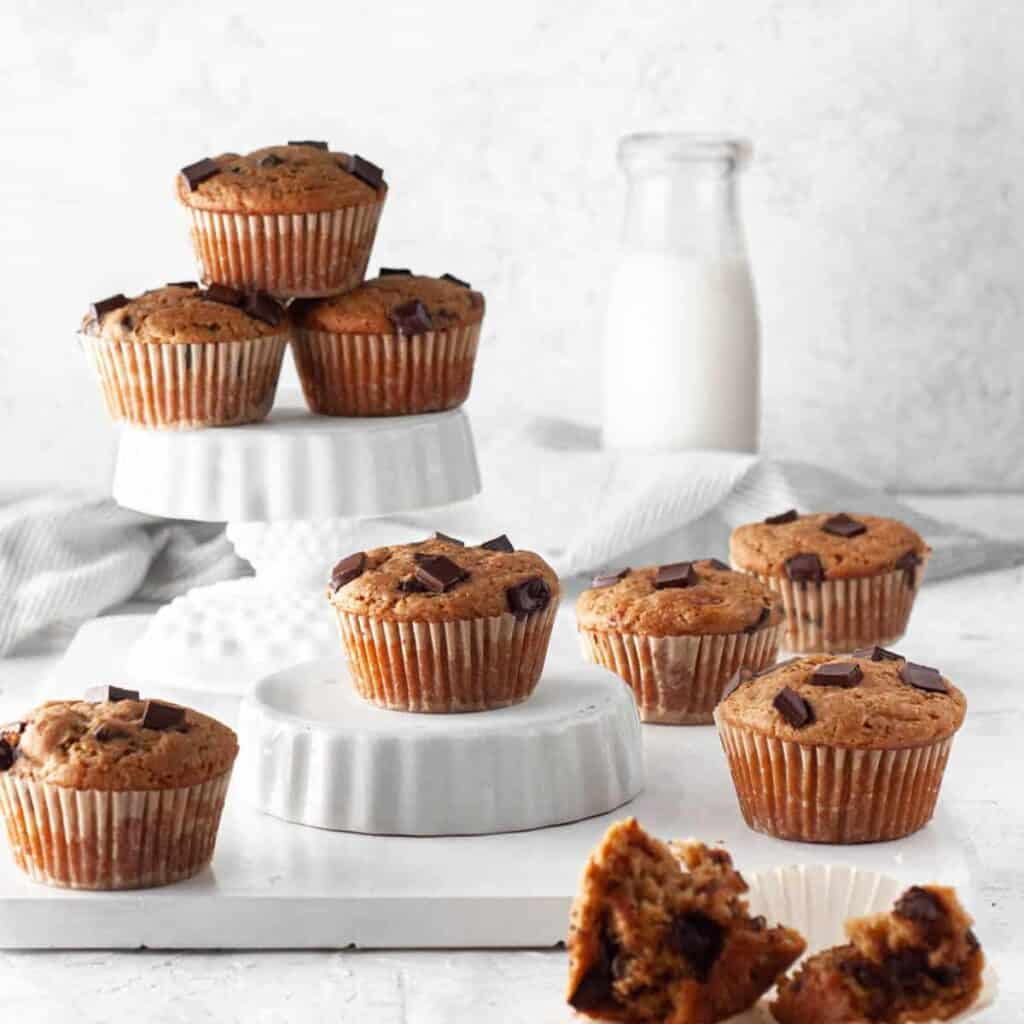 different heights of muffins with one muffin cut open