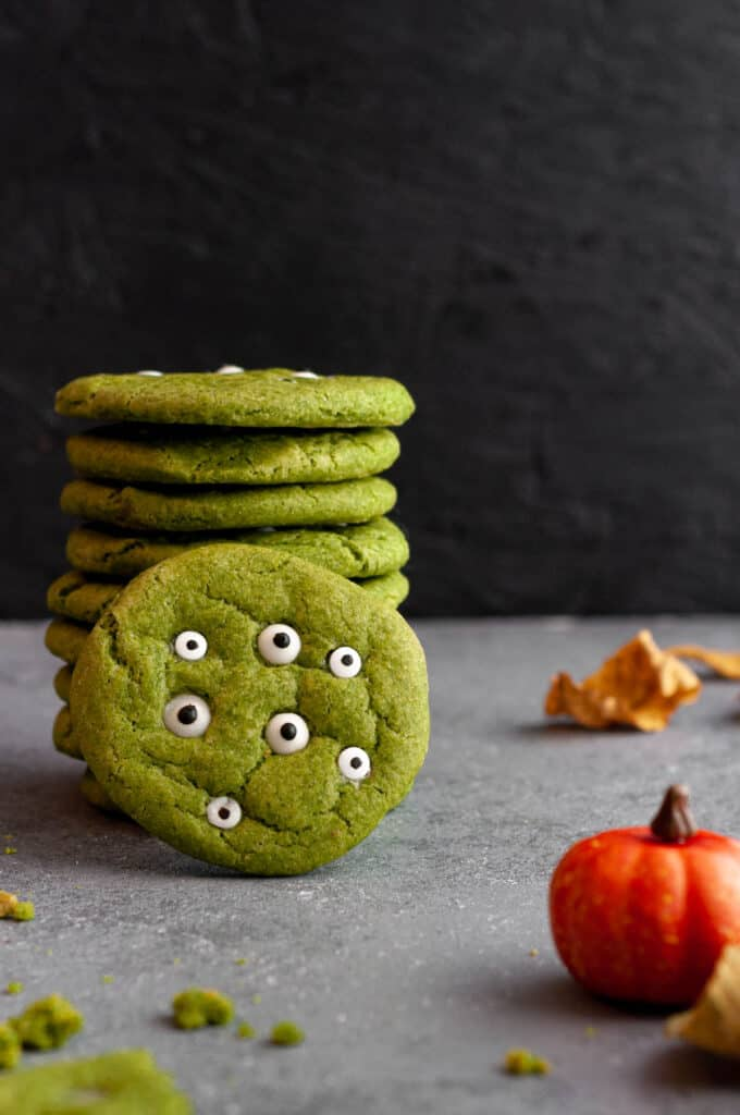 tall stack of matcha monster cookies with one cookie in front of it