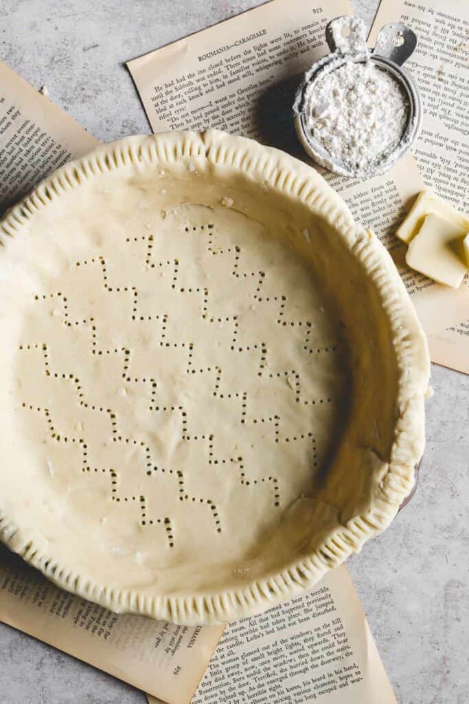 butter, flour and pie crust ontop of old book pages