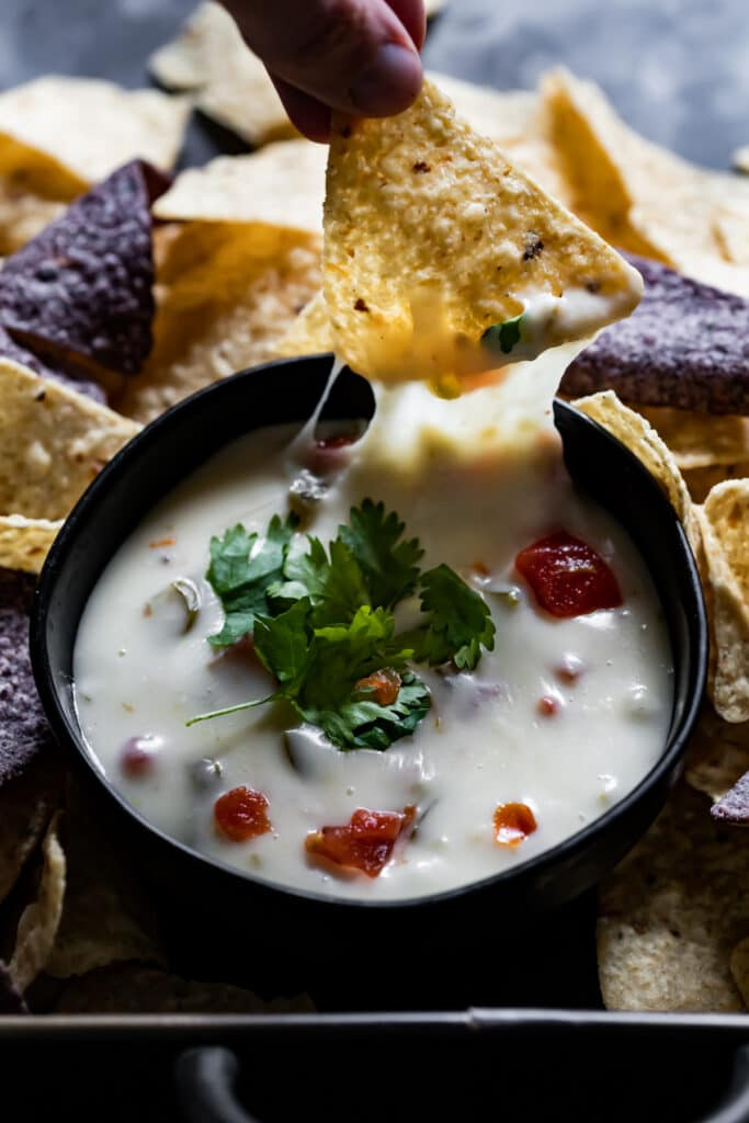 queso blanco with chip being dipped