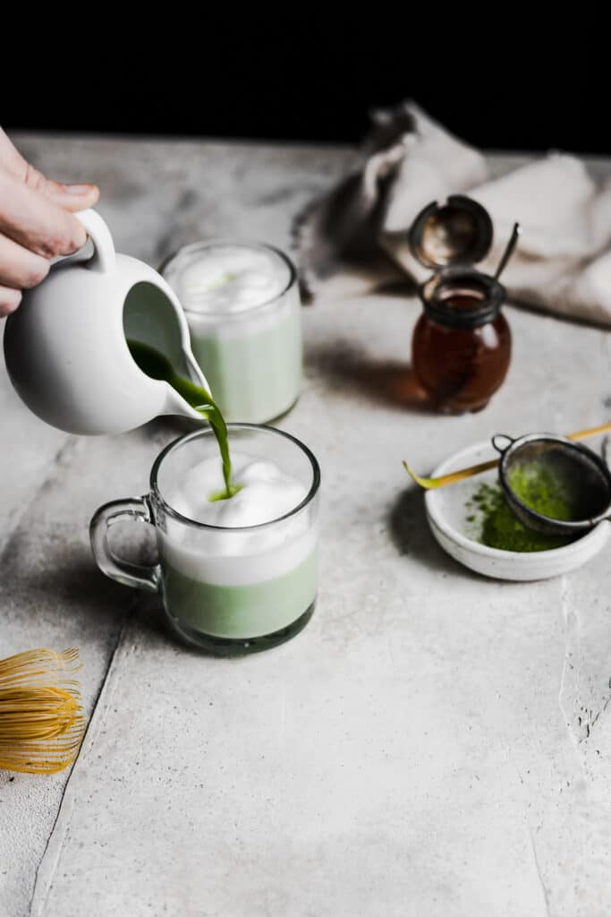 matcha being poured into frothed milk