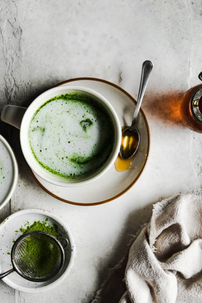 one cup of matcha latte on a plate