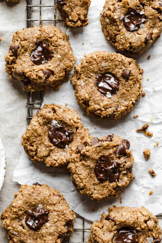 8 almond butter gluten free oatmeal cookies on a cooling rack