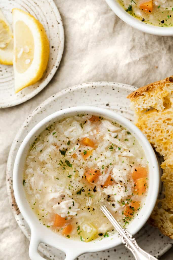 bowl of instant pot chicken and rice soup with crusty bread