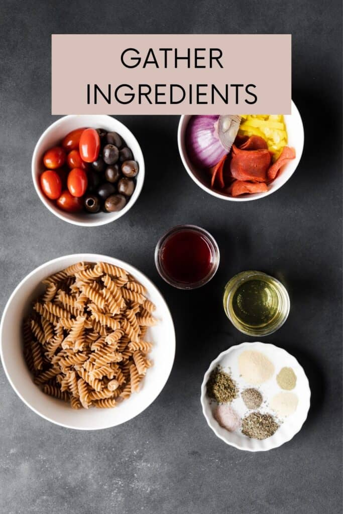 all ingredients for pasta salad in white bowls and on a black background