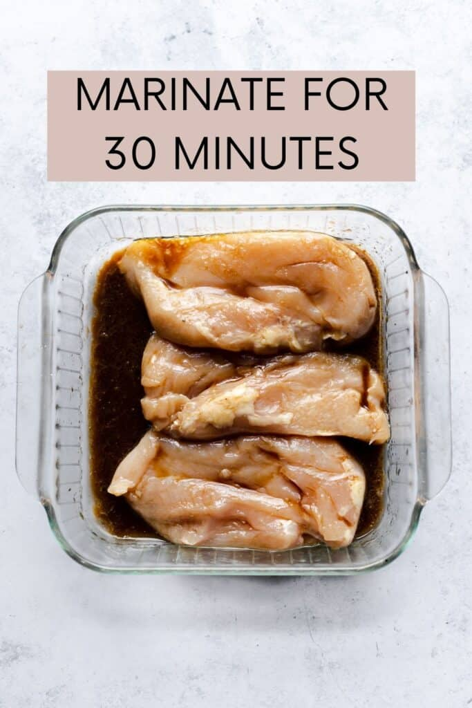 CHICKEN MARINATING IN A CLEAR DISH