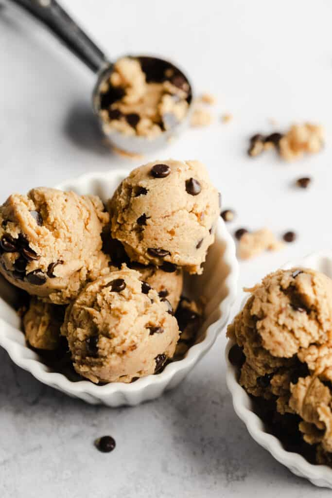 scoops of cookie dough protein in white dishes