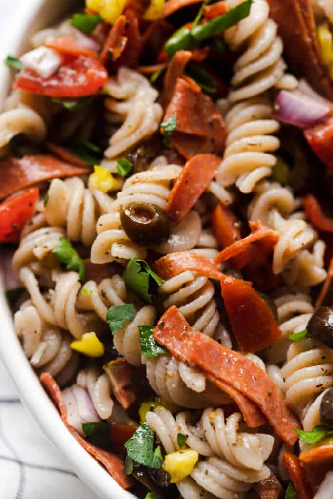 close up of finsished pasta salad in white bowl