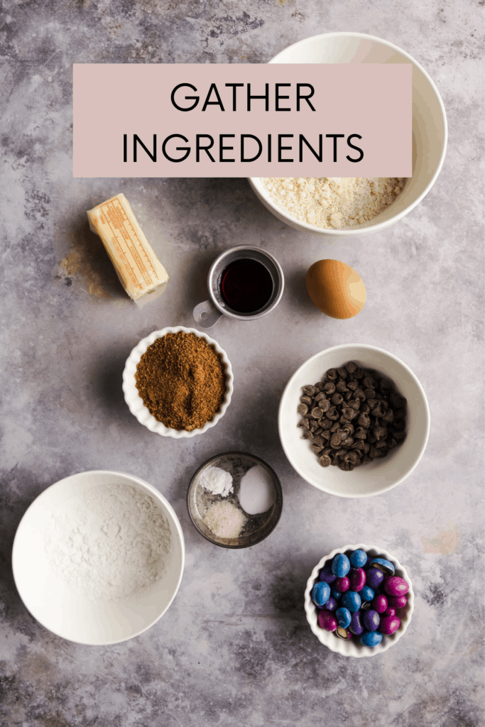 ingredients for the cookies on a grey backdrop with instructions to gather ingredients