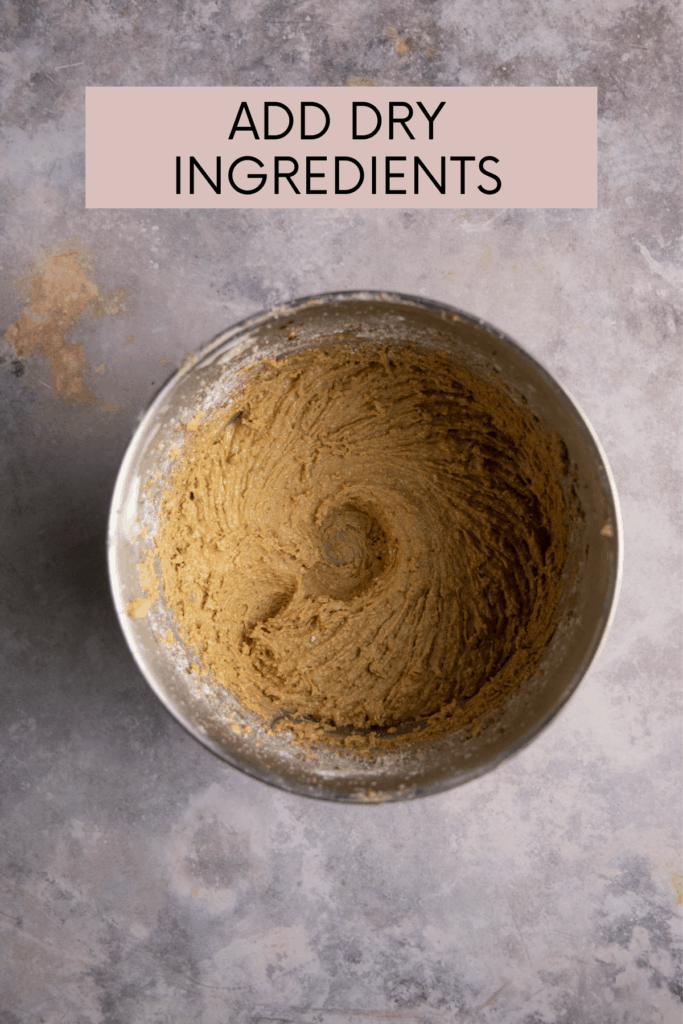 instructions to add dry ingredients with a mixing bowl of dough before chocolate is added